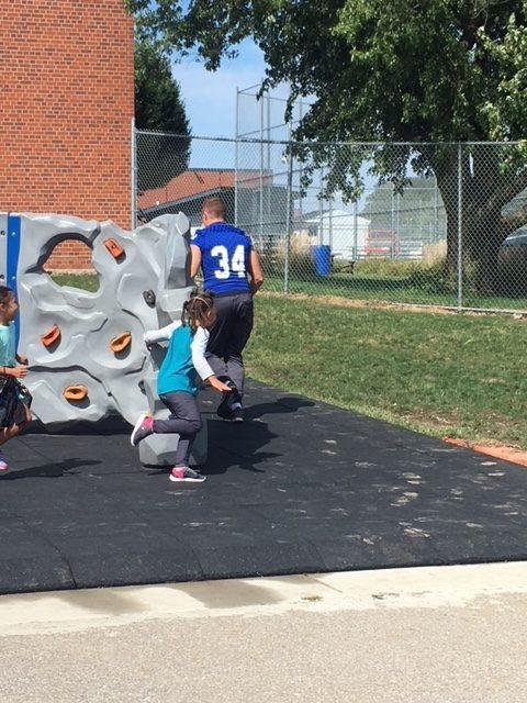 Drake Football Players Visit Hubbell